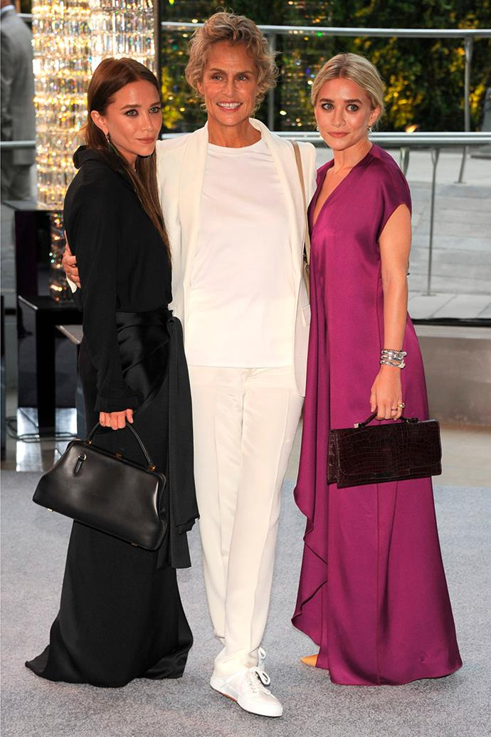 Hutton with Mary-Kate and Ashley Olsen in 2012