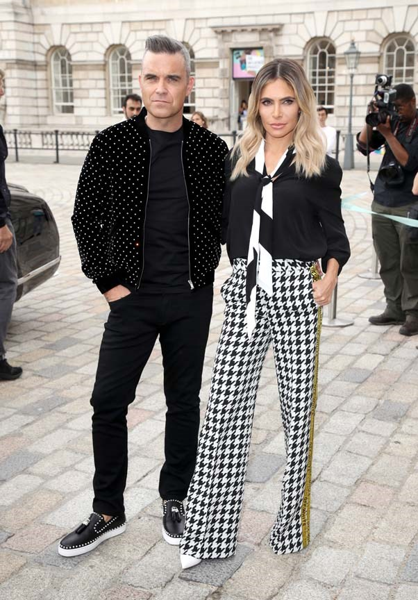 """**Robbie Williams and Ayda Field** <br><br> Surprising addition, but according to the *[Daily Mail](http://www.dailymail.co.uk/news/article-5929201/Princess-Eugenie-Robbie-Williamss-daughter-Theodora-Rose-wedding-Jack-Brooksbank.html