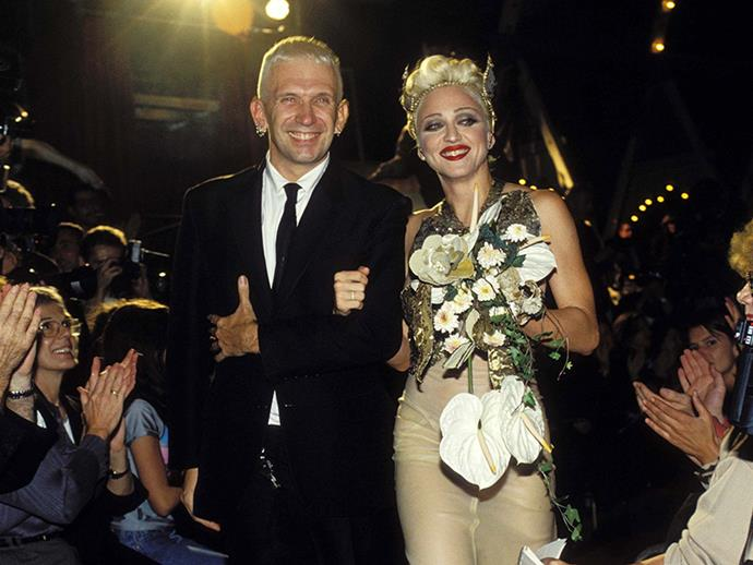 ***1994:*** Working again with Jean Paul Gaultier, Madonna paraded the runway at the label's spring/summer '95 show, pushing a vintage stroller and taking a celebratory final walk with Gaultier himself.