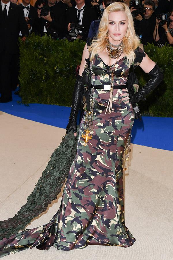 "***2017:*** Once again igniting Met Gala controversy, Madonna's camouflage [Moschino dress](https://www.harpersbazaar.com.au/fashion/moschino-milan-fashion-week-2018-15821|target=""_blank"") for the 2017 Met prompted plenty of fashion naysayers."