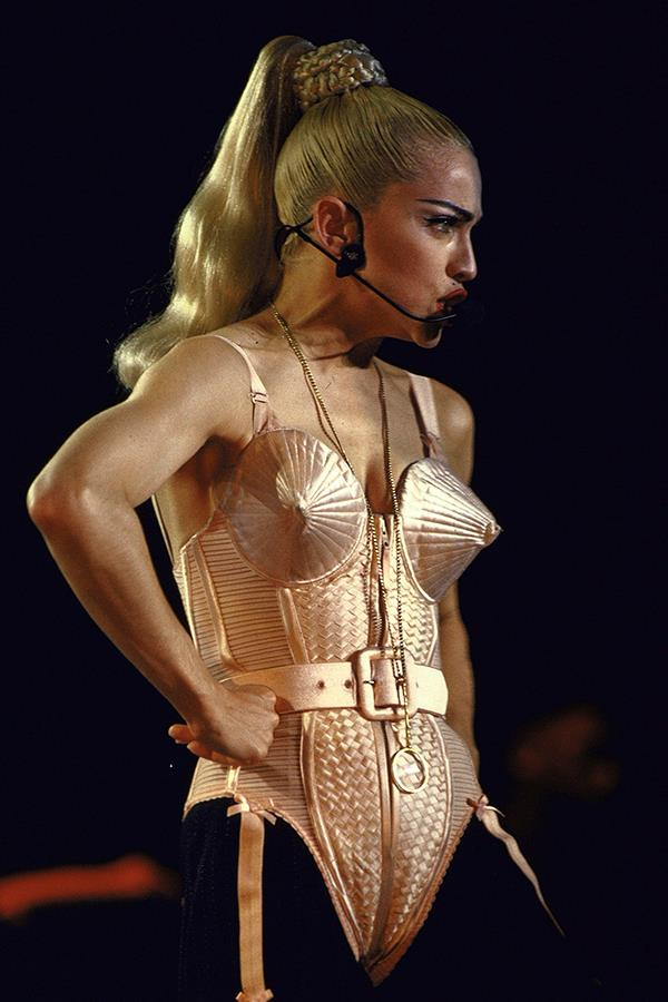 "***1990:*** Madonna's 'Blonde Ambition' world tour involved plenty of eye-catching garments, like [Jean Paul Gaultier](https://www.harpersbazaar.com.au/beauty/kim-kardashian-fragrance-backlash-16366|target=""_blank"")'s custom cone-shaped bra."