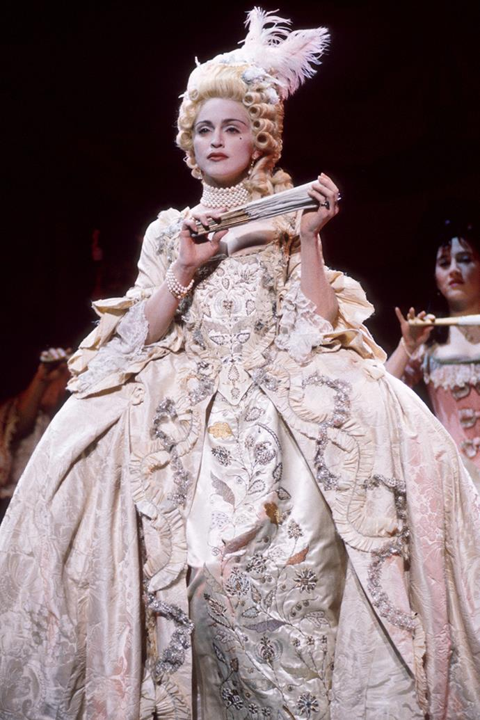 ***1990:*** At the 1990 *MTV* VMA's, Madonna wore a gown of operatic proportions to perform her then-recently released song 'Vogue'.