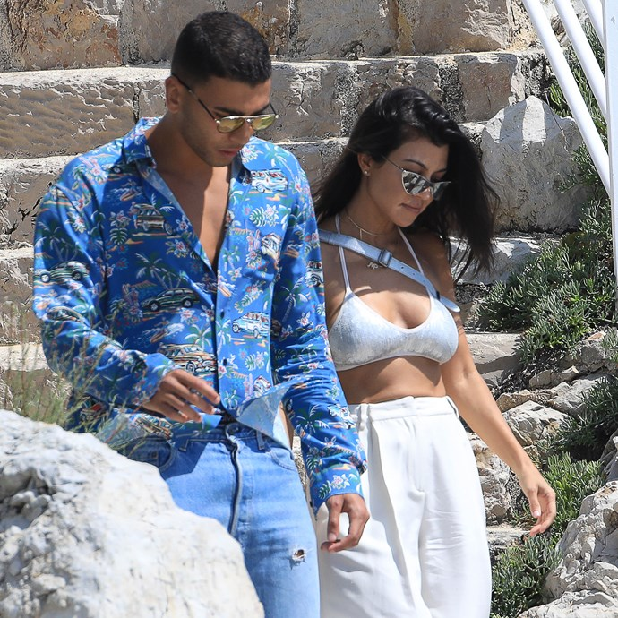 "**MAY 2017** <br><br> Kardashian travelled to the south of France for the Cannes Film Festival—oh, and to meet up with her French boyfriend. On their first official holiday as a couple, [the two were snapped](https://www.eonline.com/au/news/855454/kourtney-kardashian-and-younes-bendjima-pack-on-the-pda-near-cannes|target=""_blank""