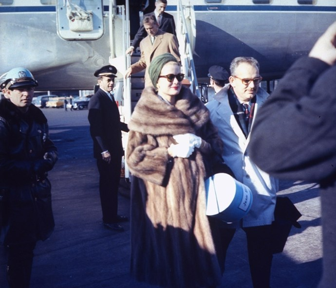 Arriving at an airport with Prince Rainier III, 1959