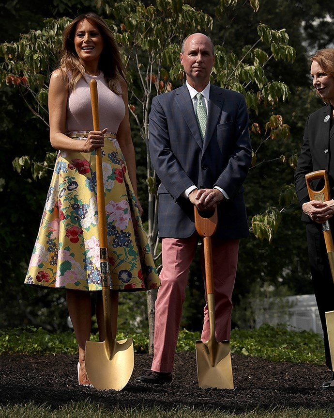 Melania Trump planted her very own oak tree in the White House gardens—while wearing a $5,400AUD skirt by Valentino and Christian Louboutin pumps, no less.