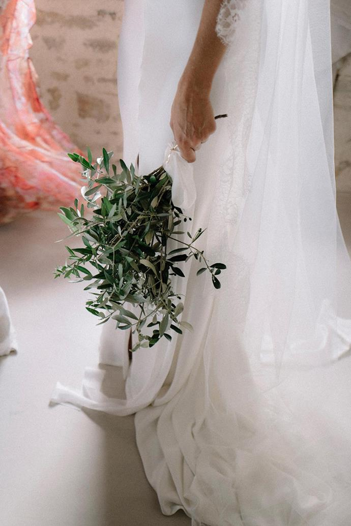 **On the flowers: ** <br><br> We had olive leaves for all of our arrangements (table décor, the ceremony chairs and in our bouquets). We thought about using baby's breath or another white flower but decided to keep it simple. The house had its own olive grove and we wanted to work with the surroundings and the beauty of the area. We put our arrangements together with 100% silk ribbon to add the colour that white blooms would otherwise have.