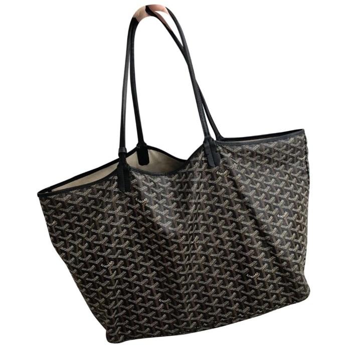 "*Goyard Saint-Louis Tote, $1,578, [Vestiaire Collective](https://www.vestiairecollective.com/women-bags/handbags/goyard/black-cloth-saint-louis-goyard-handbag-6082254.shtml|target=""_blank"")*"