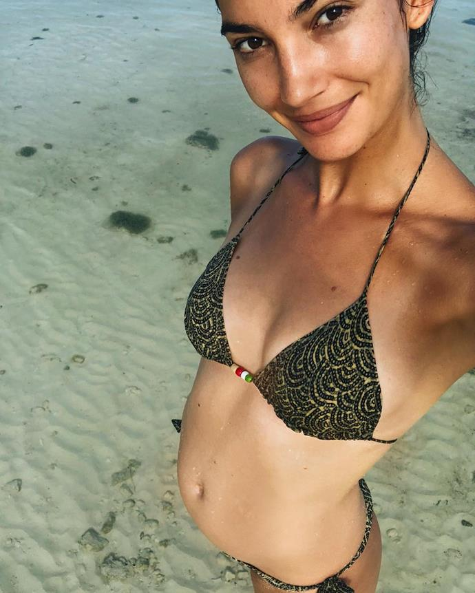 **Lily Aldridge:** Announced her second pregnancy with husband Caleb Followill with this sweet beach shot.