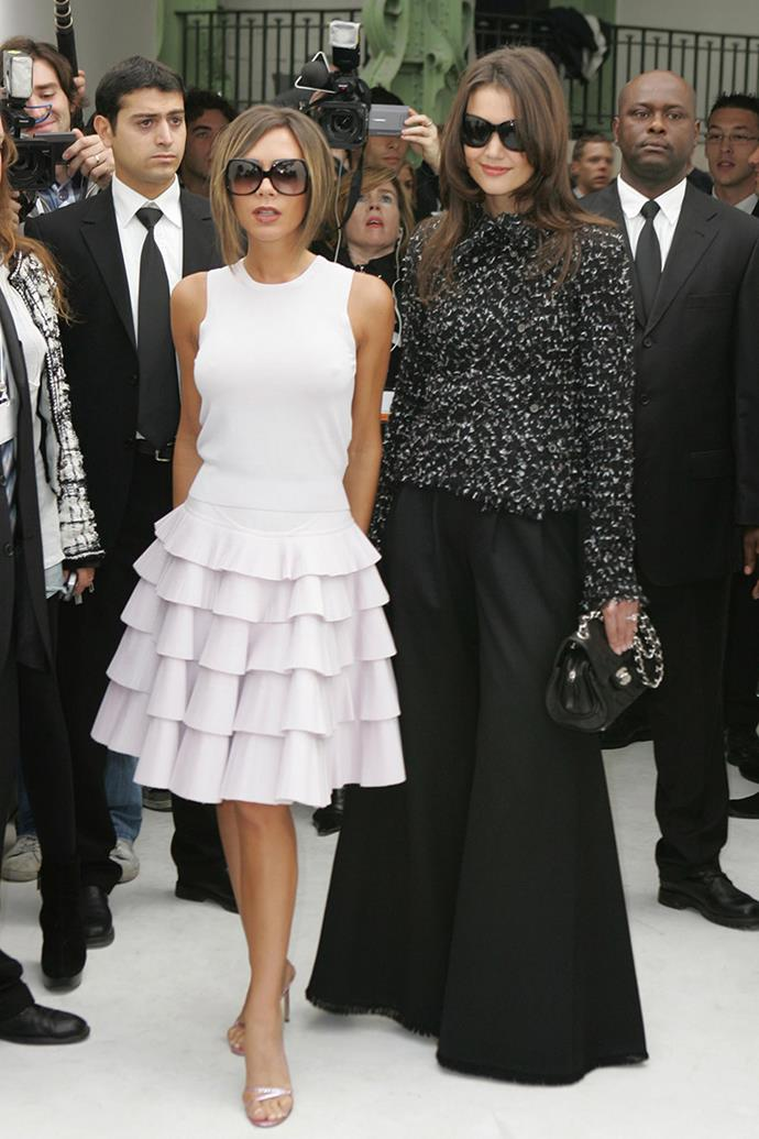 With Katie Holmes at a Chanel show, 2006