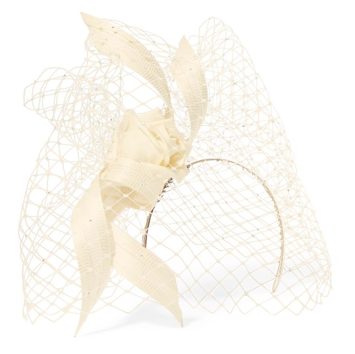 """Crafted by six artisans in London, this sculptural headpiece holds Megan Markle-level elegance—the perfect accessory come Derby Day. <br><br> Philip Treacy headpiece, $854 at [Net-a-Porter](https://www.net-a-porter.com/au/en/product/1076678/Philip_Treacy/crystal-embellished-mesh-satin-and-buntal-straw-headpiece