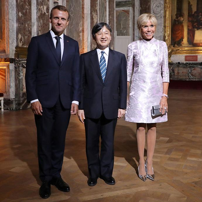 Wearing a holographic lilac minidress with a mod silhouette for a meeting with Japan's Crown Prince Naruhito at the Chateau de Versaille on September 12, 2018.