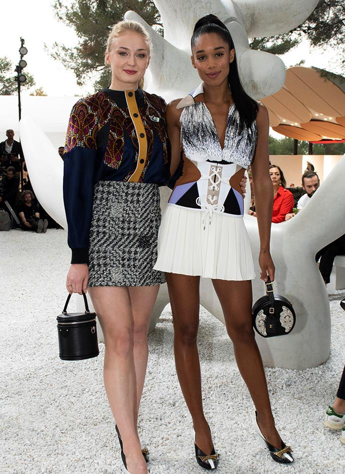 Laura Harrier with Sophie Turner at Louis Vuitton Cruise 2019, where Justin Theroux was also in attendance.