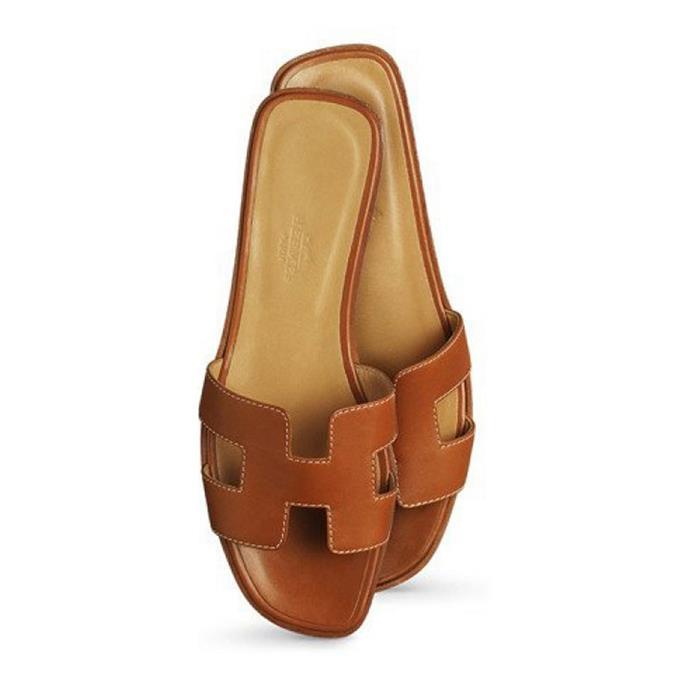 "**HERMÈS SANDALS** <br><br> Hermès Oran Sandals, $915 at [Hermès](https://www.hermes.com/au/en/product/oran-sandal-H021056Zv01350/|target=""_blank""|rel=""nofollow"")"