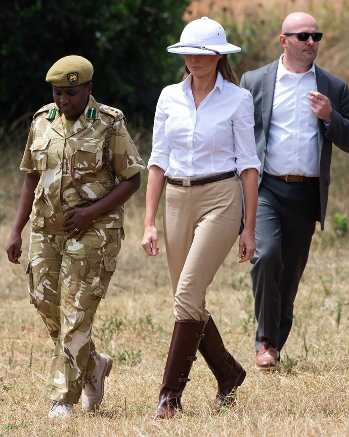 """**FOURTH MOST CONTROVERSIAL: OCTOBER 2018** <br><br> Amidst a tumultuous time for her husband's administration, the First Lady departed to Africa on her first solo overseas trip. During a safari outing, her choice of a 'pith' helmet—an item of clothing with a dark colonial history in Africa—was seen to be controversial and insensitive.  <br><br> The First Lady [addressed](https://www.harpersbazaar.com.au/fashion/melania-trump-pith-helmet-response-17463