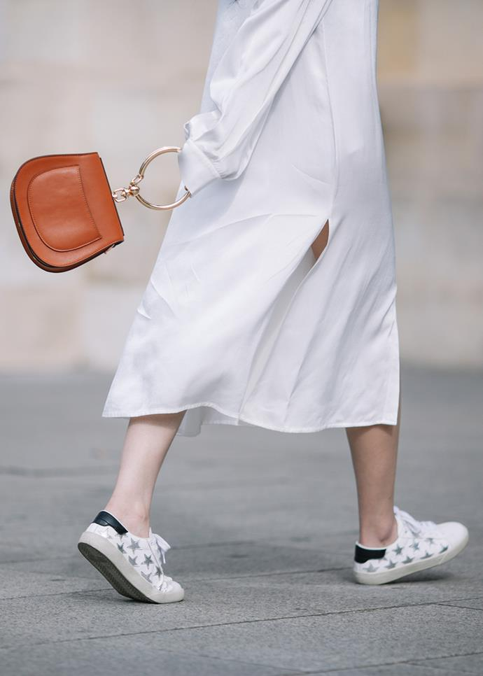 "***An everyday white sneaker***<br><br> For long lunches on weekends, casual Fridays and movie dates, a pair of white sneakers is a must. Skip embellishments, on-trend ""ugly"" shapes and bold colours, and go with a round toe, a single-sole and unobtrusive detailing."