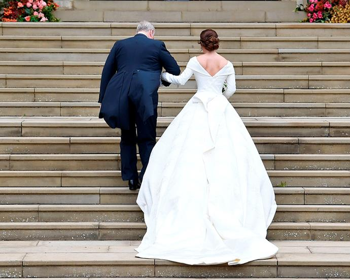 Princess Eugenie and her father, Prince Andrew, ascending the stairs at St. George's Chapel.