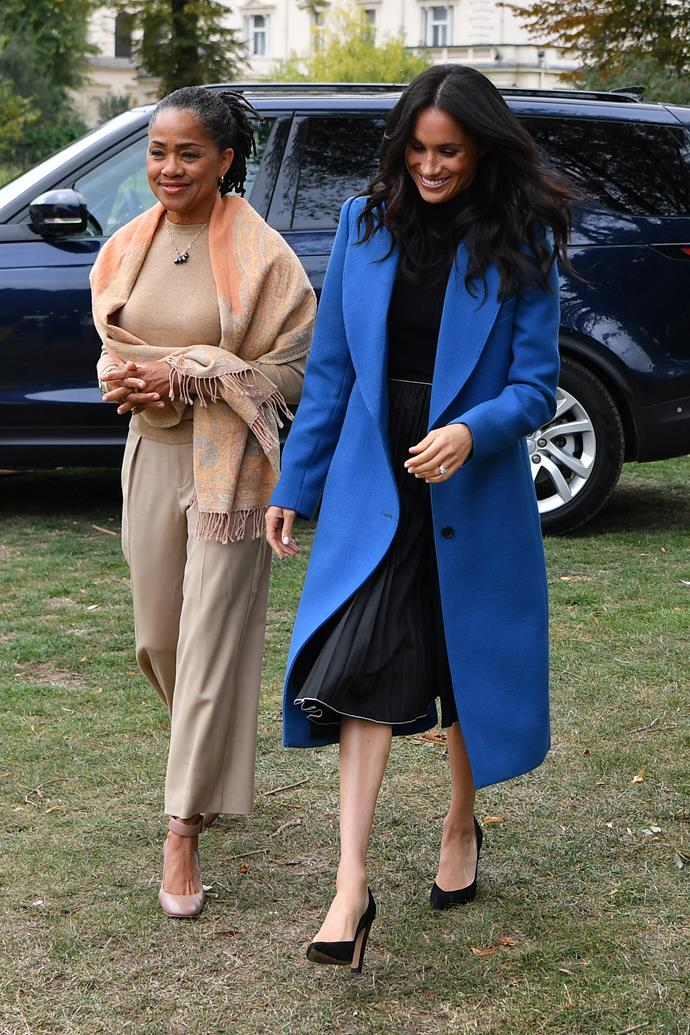 ***September 20th***<br><br> Stepping out in London, Meghan wore a dark outfit, consisting of a black skirt and top, and a heavy blue overcoat. If the black dress wasn't enough to conceal a tiny baby bump, the Duchess's cerulean coat did just the trick.