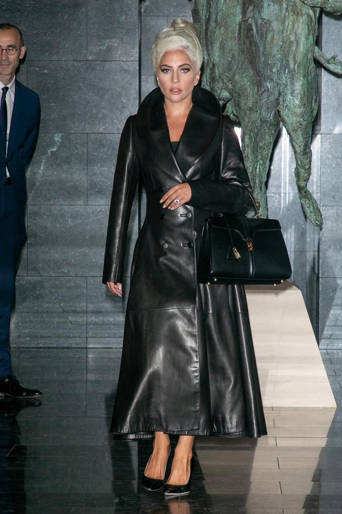 Wearing a leather Alaia trench with Celine tote dangling from arm, Gaga opted for an all black look during Paris Fashion Week.