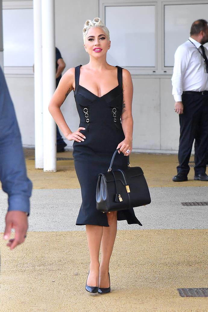 For the Venice Film Festival debut Gaga wore a simple black dress by Jonathan Simkhai, posing with a black Celine tote.
