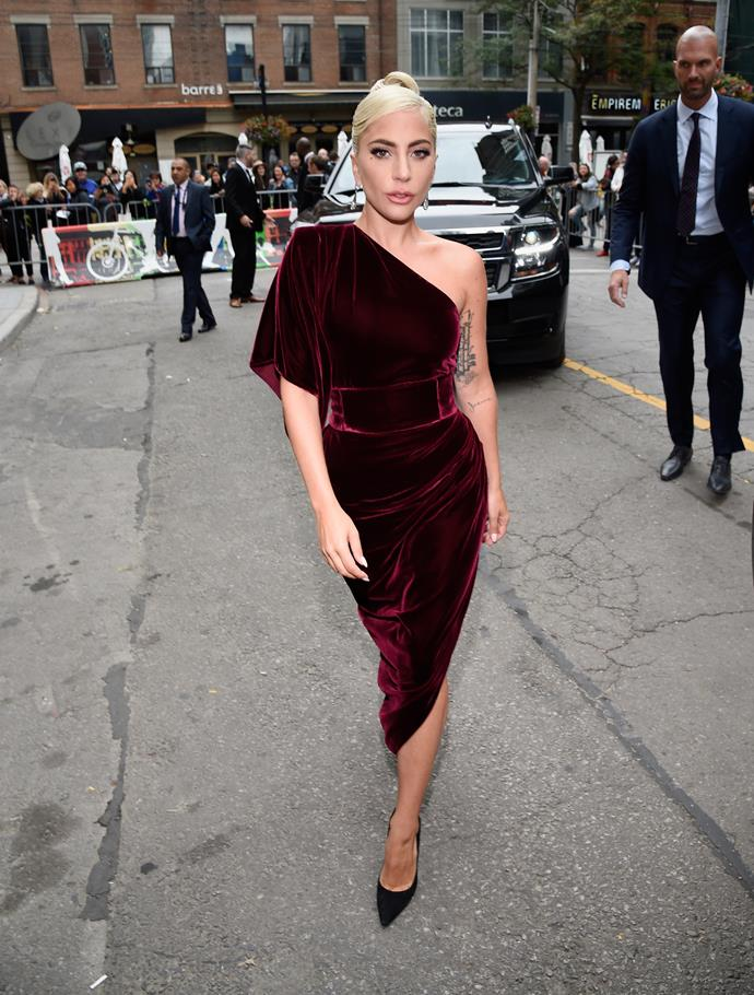 Lady Gaga sporting a burgundy velvet gown by Ralph and Russo.