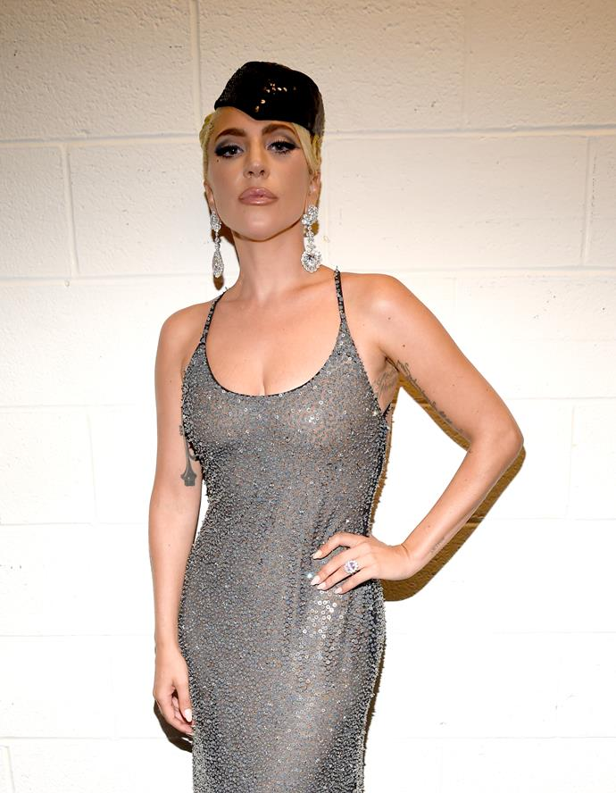 Lady Gaga paired a sheer sequined dress with statement Chopard earrings for her film's premiere in Toronto.