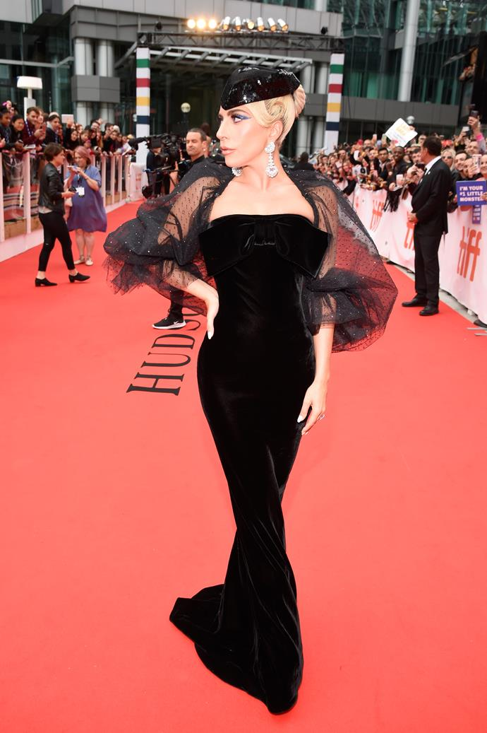 Gaga wore a black veiled, form-fitting ensemble by Armani Prive to the Toronto premiere.
