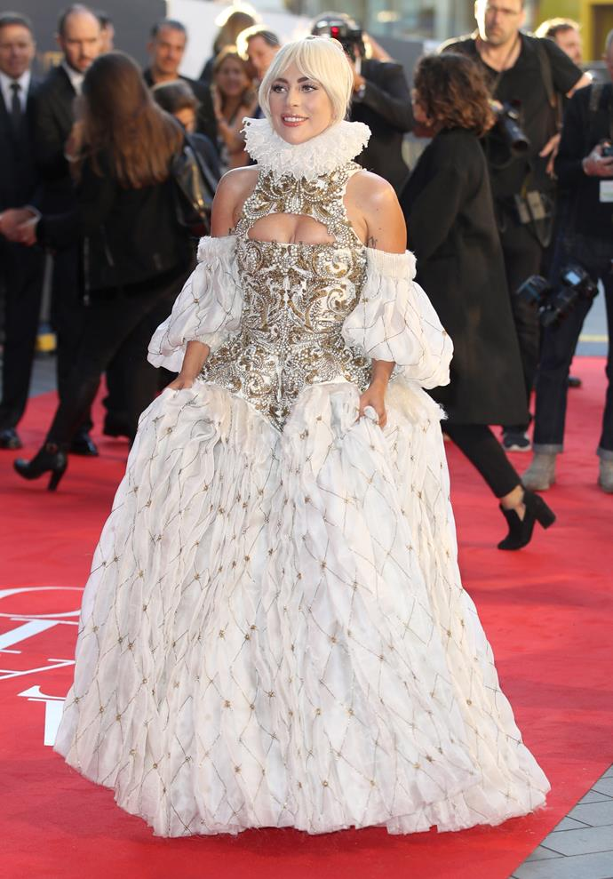 A corset gown dotted with gold and pearl embroidery, Gaga stepped out at the London premiere in Alexander McQueen.