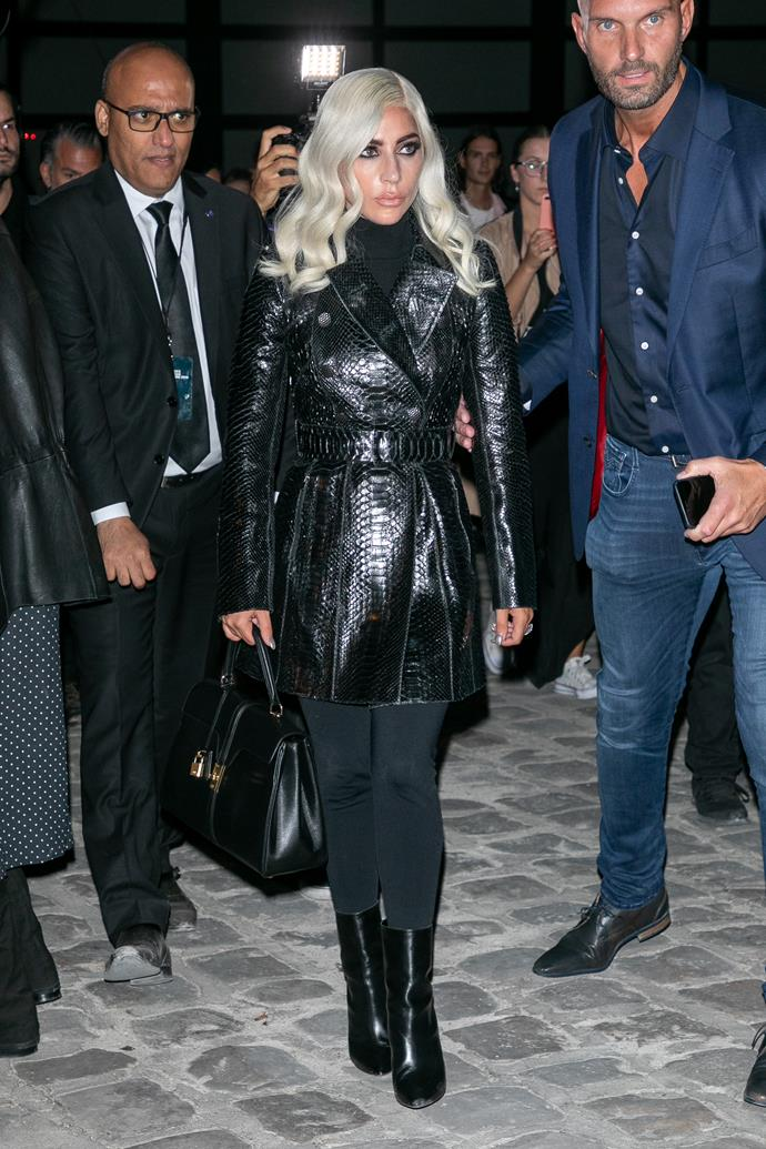 A head-to-toe look from Azzedine Alaia, Gaga looked the part at the Celine spring show in this turtleneck catsuit and python trench.