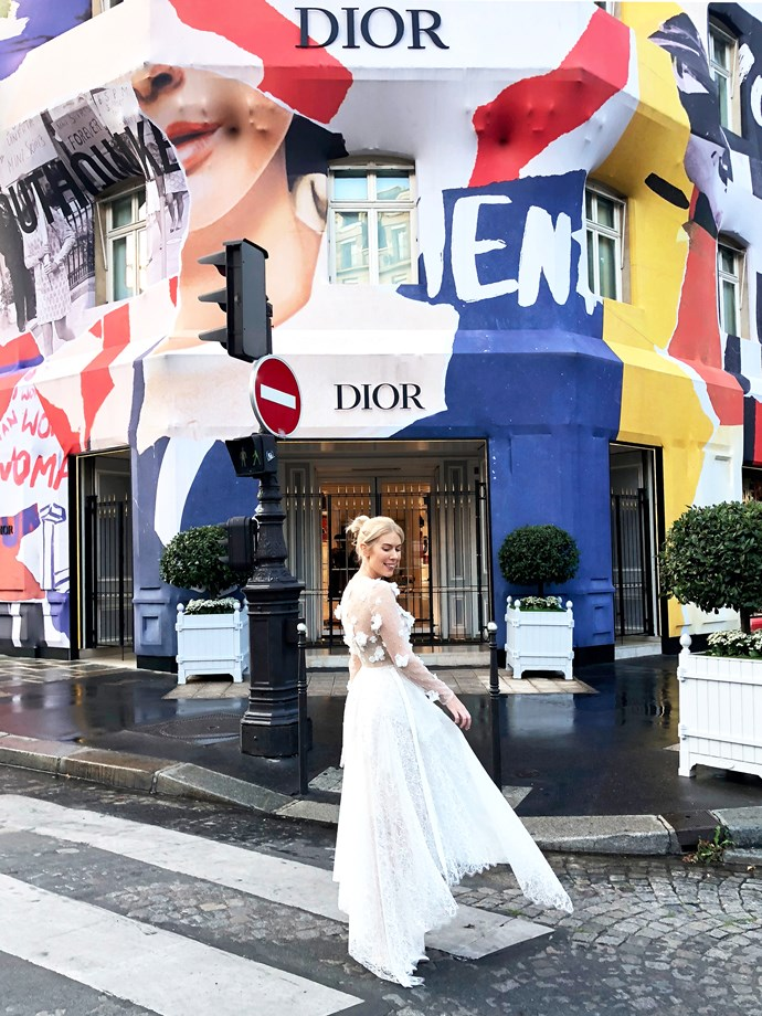 ***Dior Avenue Montaigne***<bR><br> While there are several Dior stores in Paris, the most iconic is definitely the one on the Right Bank, along Avenue Montaigne. Taking up almost three full stores including Dior jewellery and baby, there is so much Dior here to love! I have a good look in the stores after filming and then stop for a photo en route to dinner the next evening. The current modernist façade is in stark contrast to the classic grey and white Dior entry across the street. (My dress here is also George Wu.)