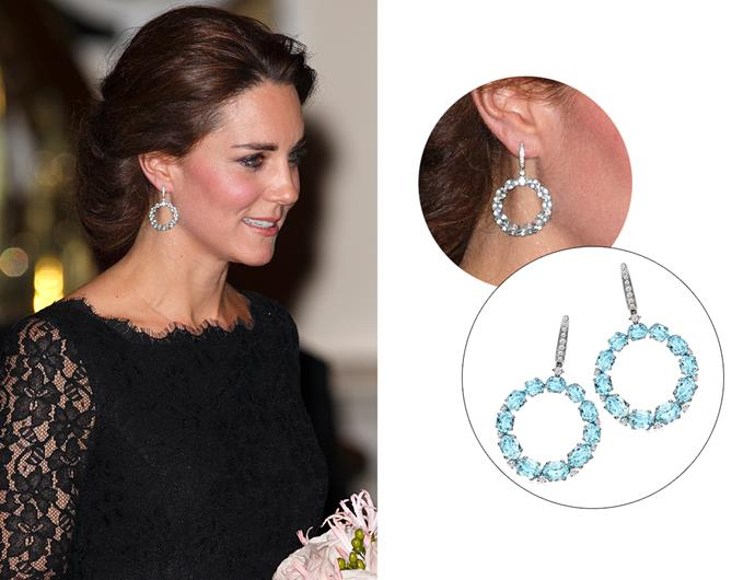 "Wearing the '[Lola Blue Topaz Hoops](https://kiki.co.uk/product/lola-large-blue-topaz-hoops/|target=""_blank""