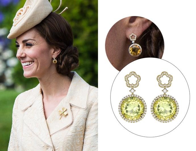 Wearing the 'Eden Diamond Flower Drop Earrings'.