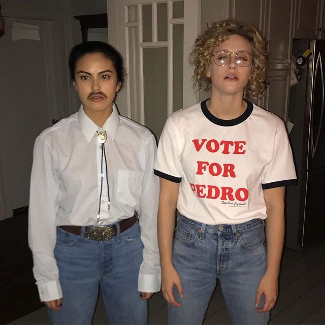 Camila Mendes and Lili Reinhart as Napoleon Dynamite and Pedro.