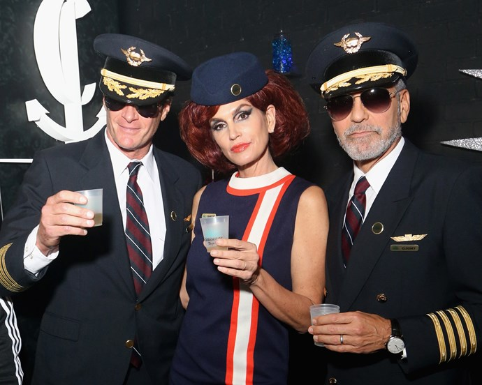 Cindy Crawford, Rande Gerber and George Clooney as retro cabin crew.