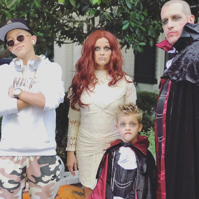 Reese Witherspoon and her family as mummies and vampires.