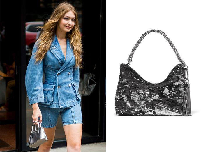"The short-strap shoulder bag—the most beloved fashion accessory of the early 00's—has re-emerged as the ultimate statement piece this season. Spotted on Gigi Hadid in recent months, here, the supermodel's double-denim ensemble is elevated with the addition of this silver metallic bag. Achieve the look with a bespoke Jimmy Choo clutch coated in shimmering double-faced sequins. <br> <br> Clutch, $1,175, Jimmy Choo at [Net-a-Porter](https://www.net-a-porter.com/au/en/product/1100607/jimmy_choo/callie-sequined-satin-clutch|target=""_blank""