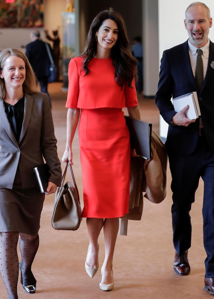 Wearing a red cape dress to the UN Headquarters in New York on 28 September, 2018.