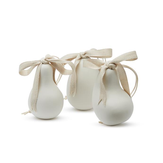 "Ornaments by Jac+ Jack x Mud, $40 each at [Jac+ Jack](https://www.jacandjack.com/ target=""_blank"" rel=""nofollow""). Available November 15th."