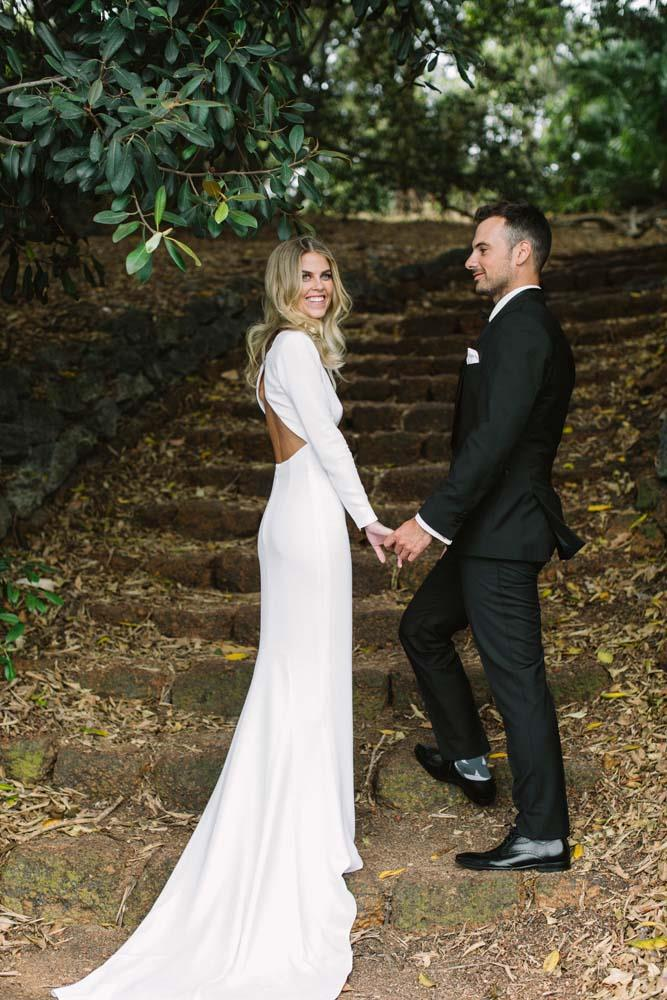 **On how they met:** Robbie and I met at a university quiz night in 2012. I was dressed as the Wicked Witch from Snow White and Robbie was dressed as a woman. He was wearing a plunging red halter neck dress—think Rebecca Judd in *that* Brownlow dress! It was obviously love at first sight!