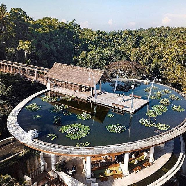 "***Four Seasons Hotel Sayan, Ubud*** <br> The lesser-known Four Seasons in Bali is hidden deep in the lush forests of Ubud, Bali's famous mountain region—and is famous for its distinctive curved design, set over the Ayung River. The renowned spa isn't exactly shabby, either. <br><br> *Book at: [Four Seasons](https://www.fourseasons.com/sayan/|target=""_blank""