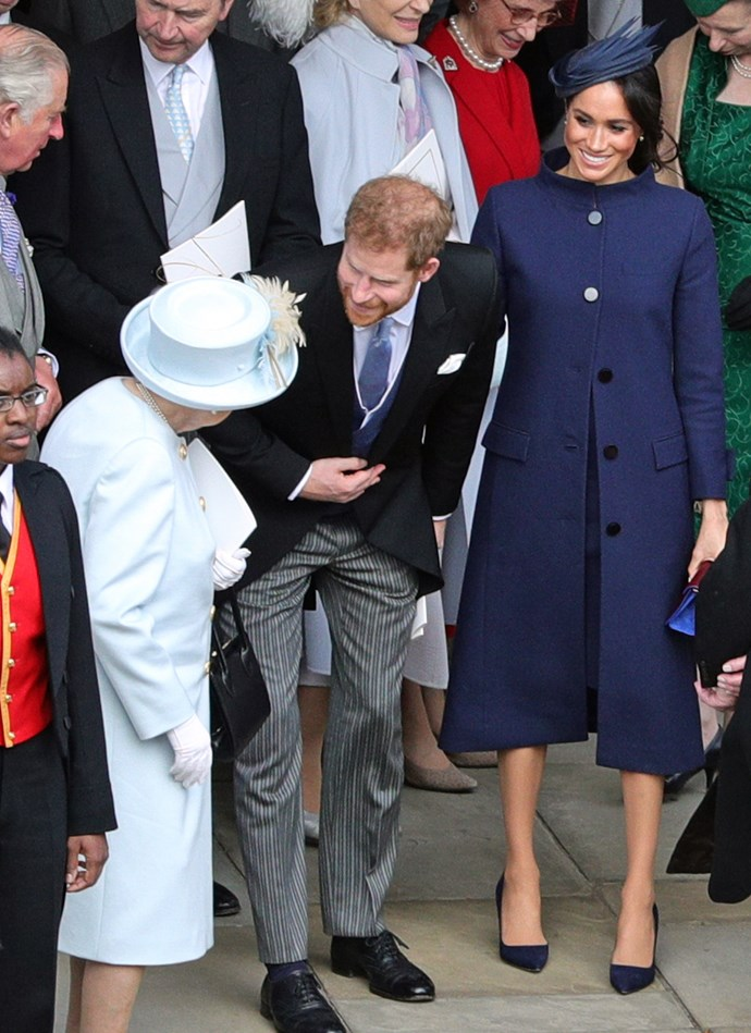 Meghan in Givenchy with husband Prince Harry and Queen Elizabeth II at the wedding of Princess Eugenie and Jack Brooksbank in October 2018.