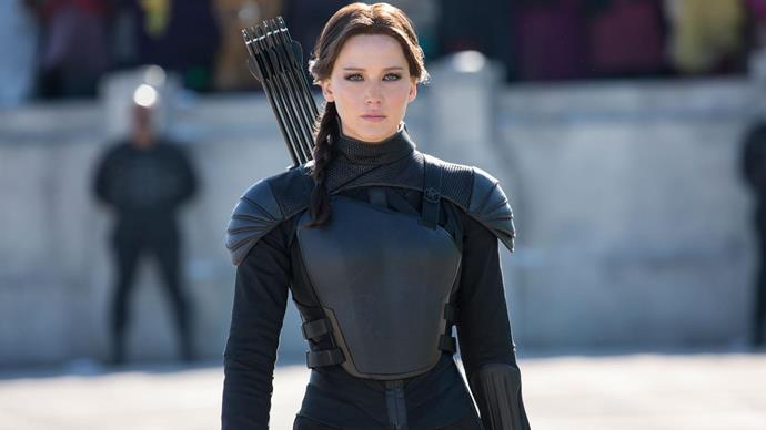 Playing heroine Katniss Everdeen in *The Hunger Games*.