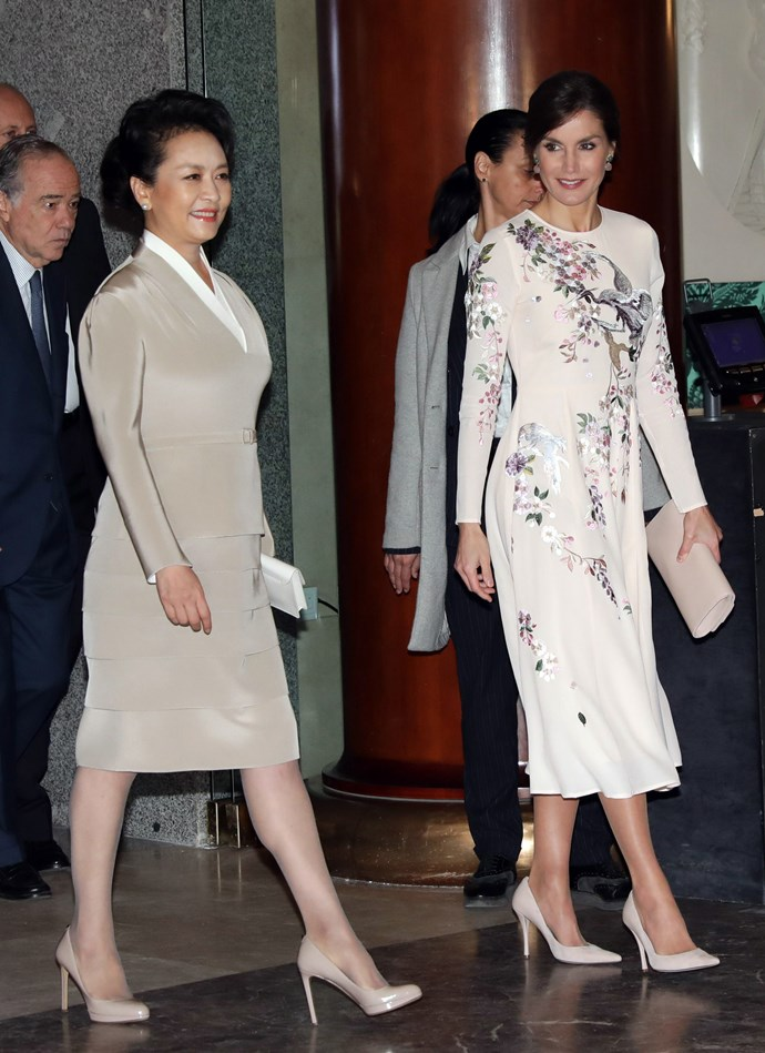 Admired for her frequent embrace of affordable fashion, Letizia paired the AU$167 dress with a clutch by Margrit, and nude suede heels.