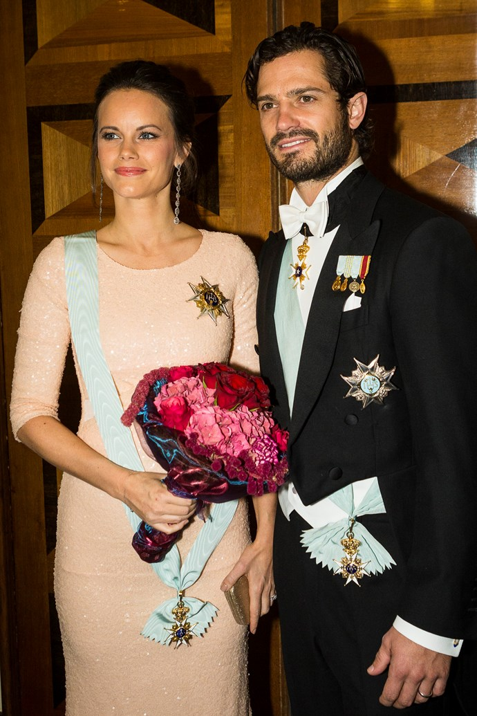 Accompanied by her husband Prince Carl, the peach-coloured gown was coincidentally complemented by Sofia's light blue royal sash.