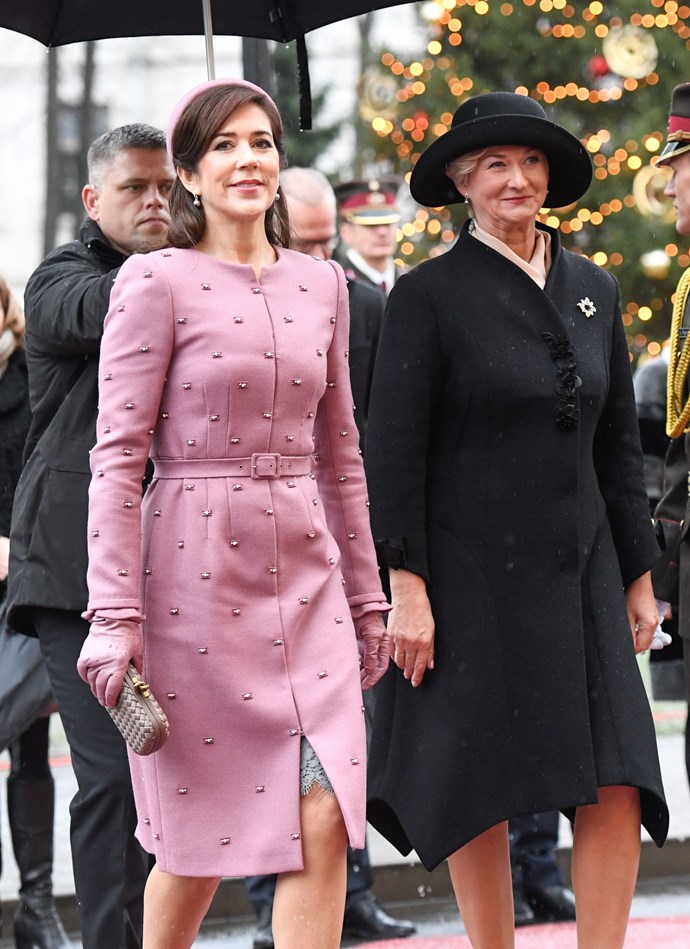 "**December 2018** <br><br> Princess Mary visited Latvia and took to the streets in an embroidered pink dress and hat and Bottega Veneta clutch, and resembled US First Lady [Jacqueline Kennedy](https://www.harpersbazaar.com.au/visionary-women/jackie-kennedy-onassis-best-fashion-17051|target=""_blank"")'s famous pink Chanel tweed outfit. Mary is pictured here with Latvian First Lady Iveta Vejone."