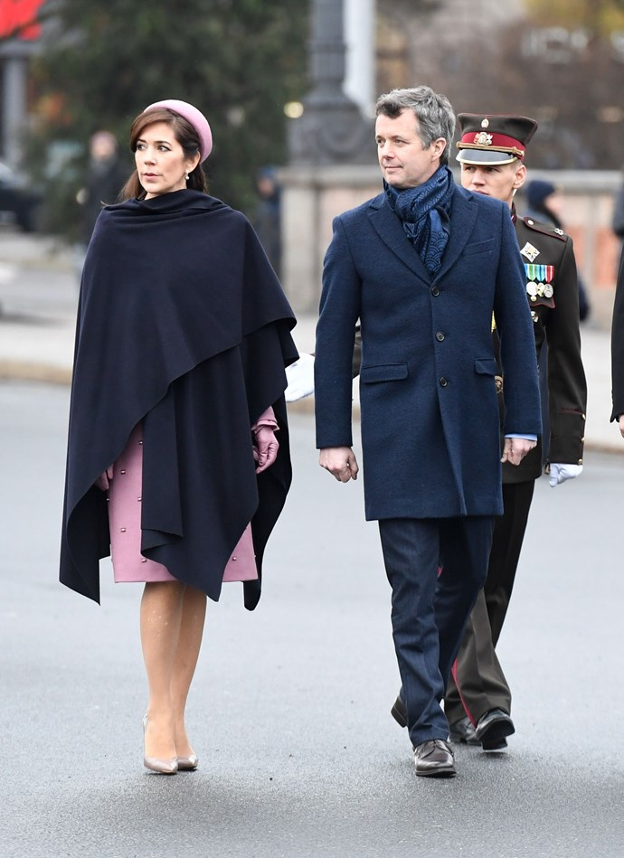 **December 2018** <br><br> When the weather in the Latvian capital of Riga took a turn for the chillier, Mary draped a dark navy shawl over her intricate dress to stay warm. Pictured here with her husband, Crown Prince Fredrik of Denmark.
