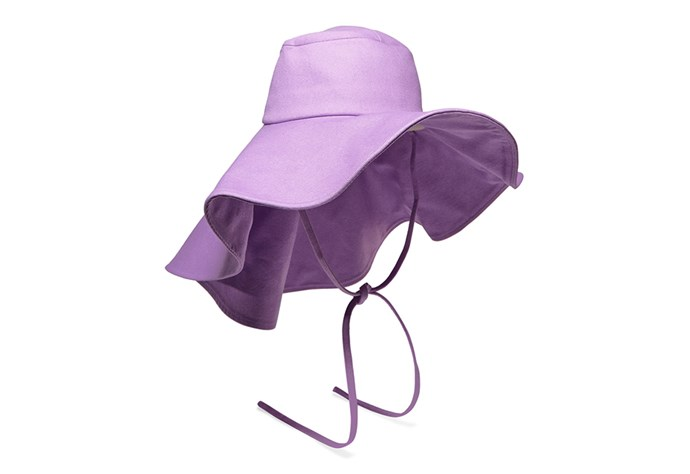 "Far easier to transport in your suitcase than your wide-brimmed straw hat, Regina Pyro's purple denim 'Daisy' hat is the vibrant, out-of-town alternative. Loaded with vacation-ready spirit it features a wide whimsical brim and matching necktie (ideal for breezy days by the sea). <br><br> Rejina Pyro, $453.36 at [Net-a-Porter](https://www.net-a-porter.com/au/en/product/1117829/rejina_pyo/daisy-denim-hat|target=""_blank""