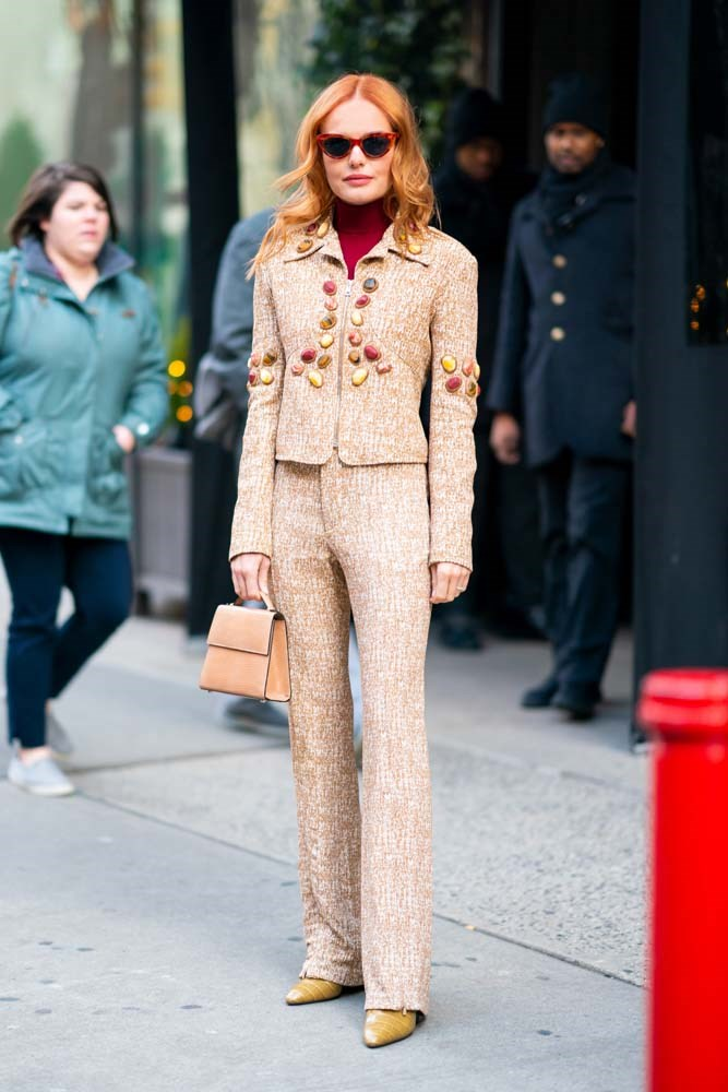 In a Chloé suit and Hunting Season bag.