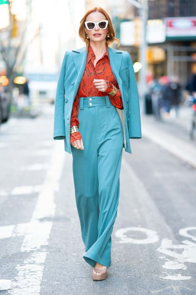 In a Proenza Schouler suit and Chloe shirt.