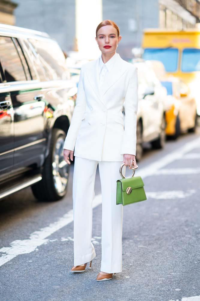 In a Gabriela Hearst suit and Benedetta Bruzziches bag.