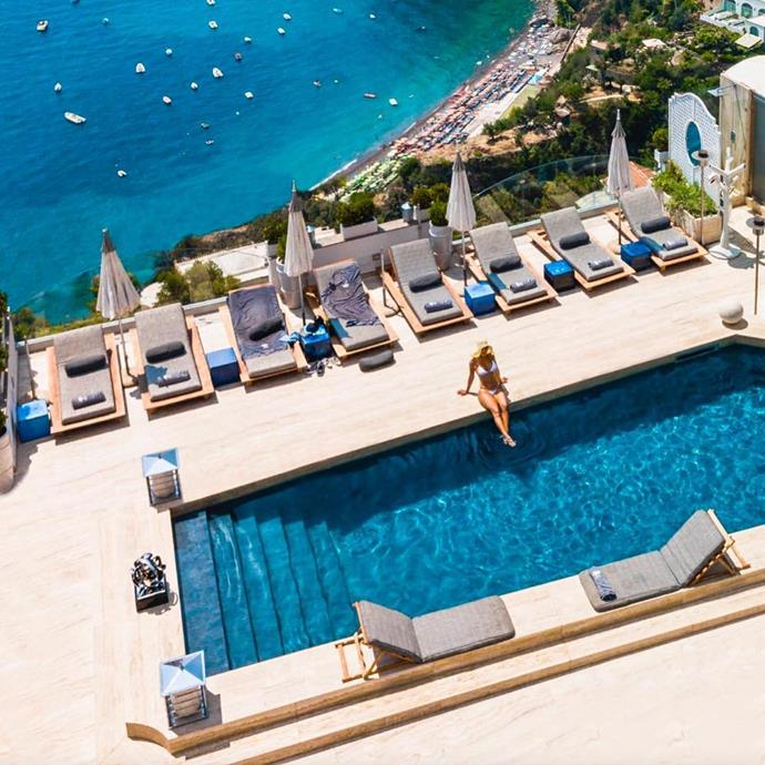 """***[Villa Franca, Positano](https://www.villafrancahotel.it/en/ target=""""_blank"""" rel=""""nofollow"""")***: White tiled flooring, Greek-inspired archways, soft grey details and—of course—that pool. Villa Franca offers several suite options that overlook the Mediterrean sea. The boutique hotel also had a terrace restaurant, a rooftop pool and a spa."""